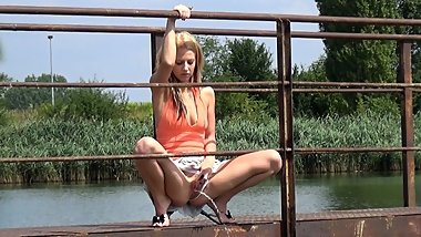 Pretty Blonde Babe Pisses Off Bridge Into River
